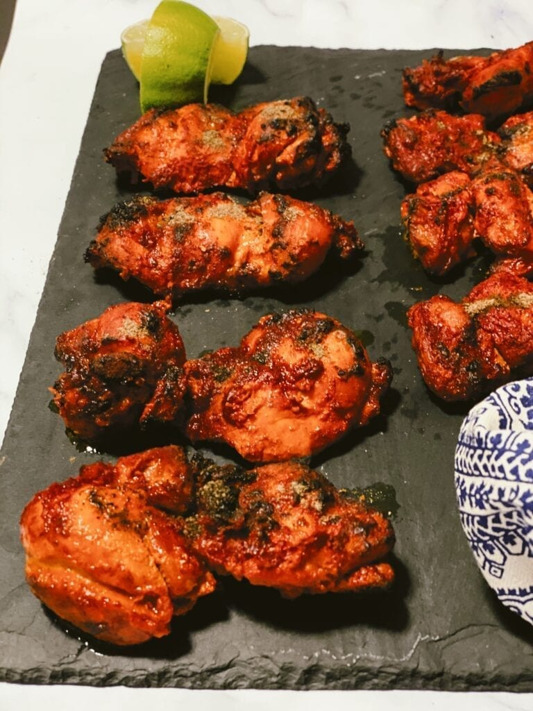 juicy tandoori chicken on a plate
