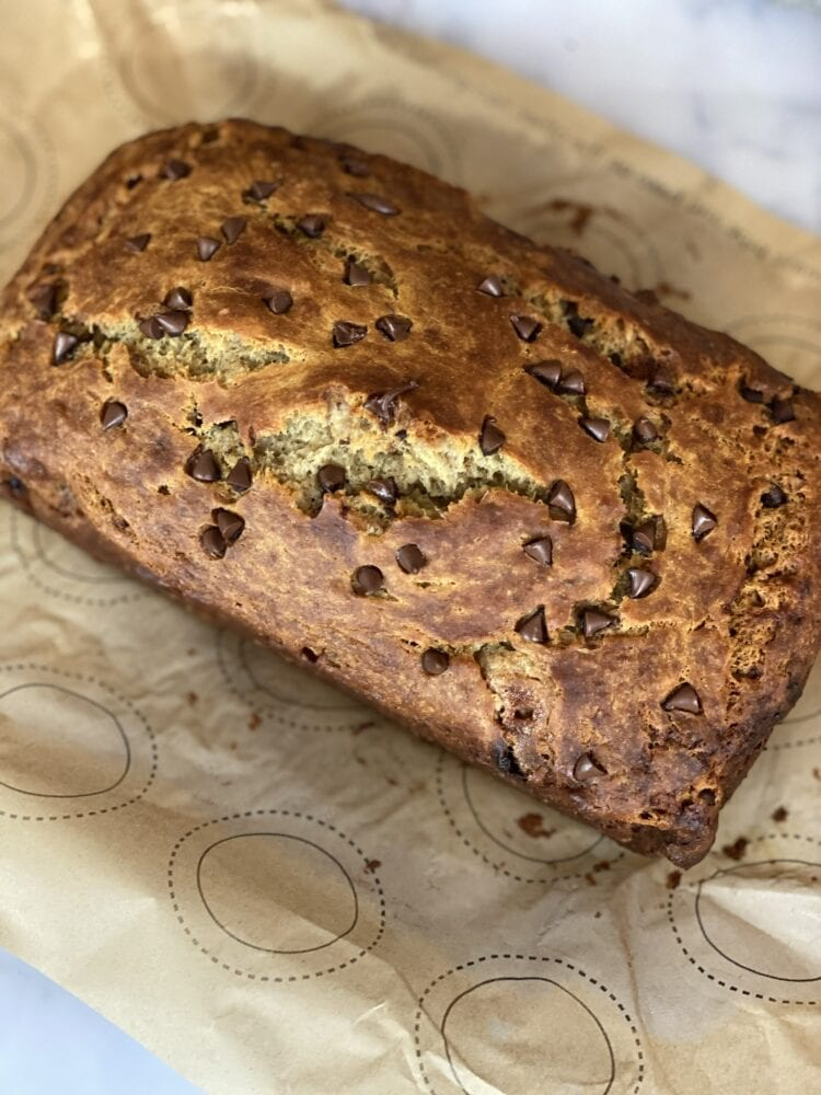 Chocolate Chip Sourdough Banana Bread on Parchment Paper