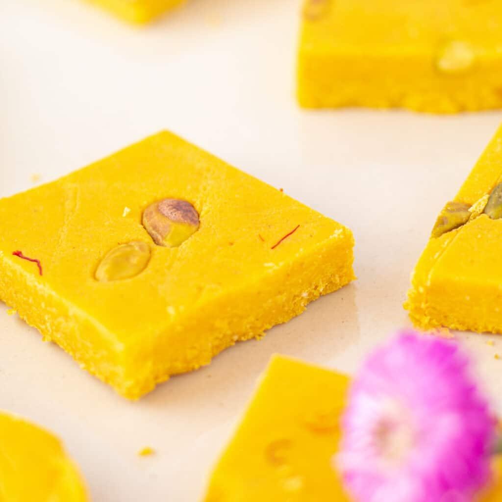 close up mango barfi with pistachio pieces