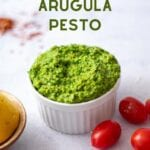 spicy summer arugula pesto in a pot with text overlay