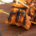 close up of chicken tikka on skewed